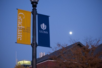 Graduate School and UConn banners hang in Fairfield Way.