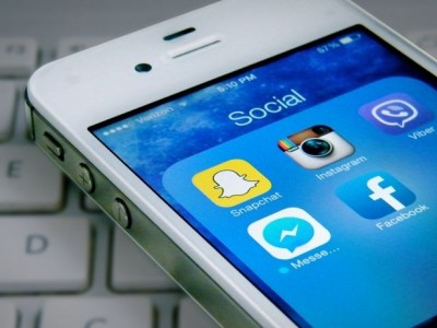 photo of iPhone with social media apps