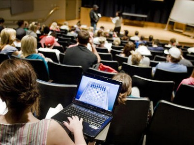 photo of student in class with game on laptop