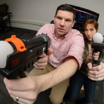 Rory McGloin and Kirstie Farrar with a video game on March 12, 2015. (Peter Morenus/UConn Photo)