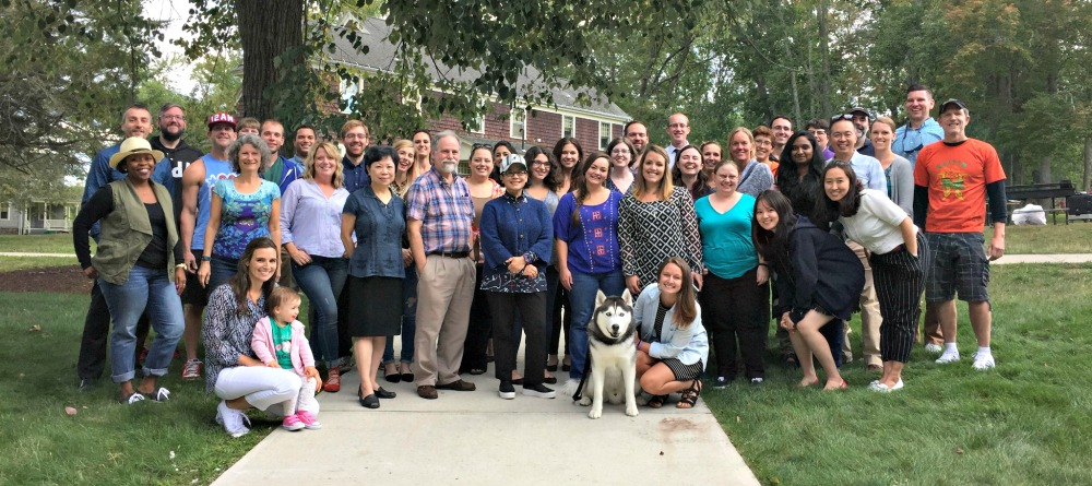 Communication Department with Jonathan the Husky
