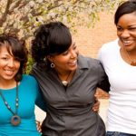 three Black women linking arms