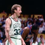Basketball player Larry Bird talking while playing