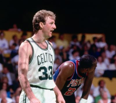 Basketball player Larry Bird talking while playing