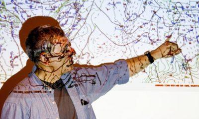 scientist presenting weather patterns