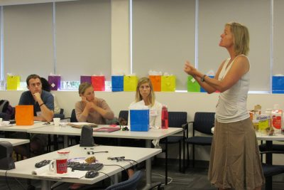 photo of Kristine Nowak presenting to grad students
